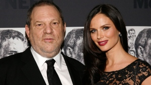 FILE - In this Dec. 3, 2012 file photo, producer Harvey Weinstein, left, and his wife, fashion designer Georgina Chapman attend the Museum of Modern Art Film Benefit Tribute to Quentin Tarantino in New York. (Photo by Andy Kropa/Invision/AP, File)