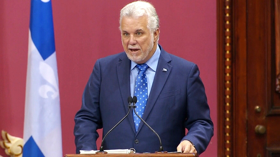 Quebec Premier Philippe Couillard speaks after shuffling his cabinet, in Quebec City, Wednesday, Oct. 11, 2017.