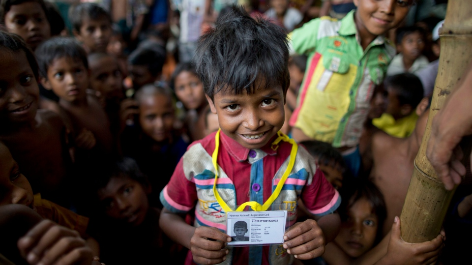 In this Sunday, Oct. 1, 2017 photo, Mohammad Rofique smiles with an identity card he just received from Bangladesh authorities at Kutupalong, Bangladesh. (AP / Gemunu Amarasinghe)