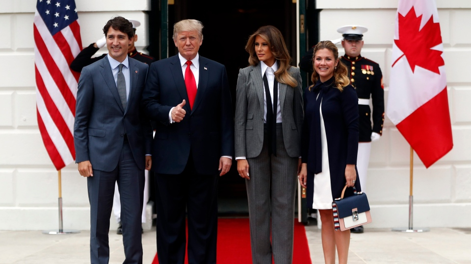 U.S. President Donald Trump and first lady Melania Trump pose for a photo as they welcome Prime Minister Justin Trudeau and his wife Sophie Gregoire Trudeau to the White House in Washington, Wednesday, Oct. 11, 2017. (AP Photo/Pablo Martinez Monsivais)