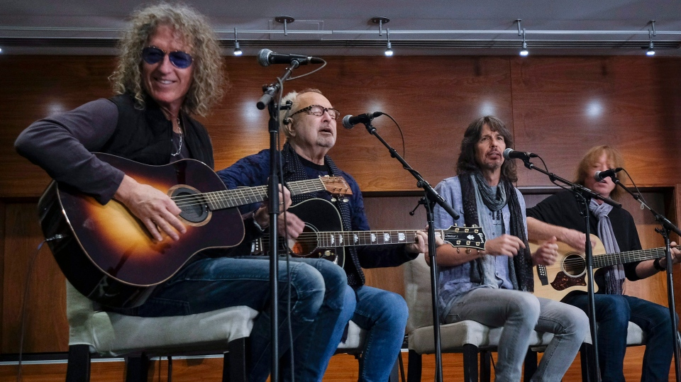 "Members of the rock band Foreigner, left to right, Michael Bluestein, Mick Jones, Kelly Hansen, and Jeff Pilson perform at a news conference about an upcoming musical called ""Jukebox Hero,"" in Calgary, Alta., Oct. 11, 2017. (THE CANADIAN PRESS / Jeff McIntosh)"