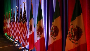In this Aug. 16, 2017 file photo, the national flags of Canada, from left, the U.S. and Mexico, are lit by stage lights before a news conference, at the start of North American Free Trade Agreement renegotiations in Washington D.C. (AP Photo/Jacquelyn Martin, File)
