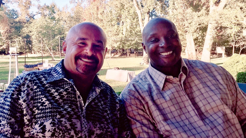 Grant Fuhr and Sterling Sharpe are seen in a photo taken at the Ronnie Lott charity golf tournament. Supplied.