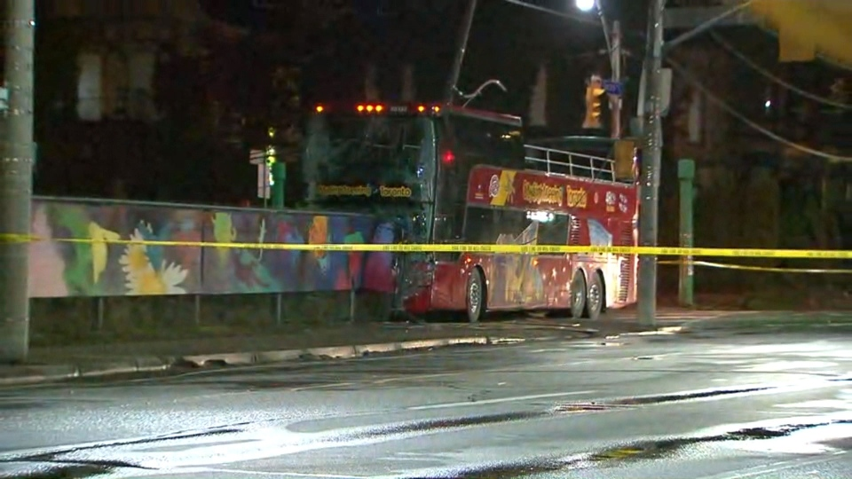 Police tape cordons off the scene of a collision between a double-decker bus and a car in Cabbagetown Wednesday October 11, 2017.