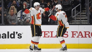 Calgary Flames centre Sean Monahan, left, celebrates his game-winning goal with defenceman TJ Brodie during the overtime period of an NHL hockey game against the Los Angeles Kings in Los Angeles on Wednesday, Oct. 11, 2017. (AP / Mark J. Terrill)