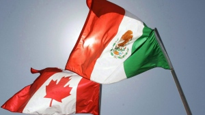 United States (unseen), Canada, and Mexico fly in the breeze in New Orleans. The Canadian government is getting kudos from unions for proposing that both Mexico and the United States commit to improved labour standards in a rewritten North American free trade agreement. THE CANADIAN PRESS/AP/Judi Bottoni