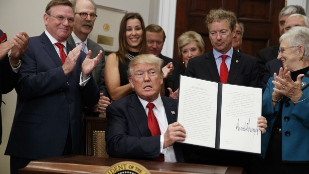 Calling it a beginning, Trump signs health care order