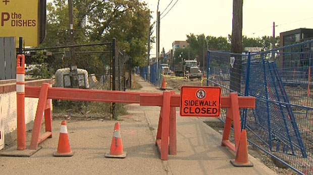 Businesses along 17 Avenue are anxious now that they've learned construction will take about a month longer to complete.