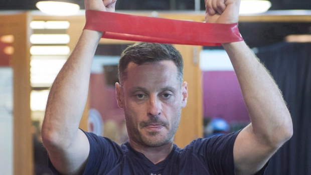 Montreal Canadiens defenceman Mark Streit, from Switzerland, stretches during medical exams on the first day of training camp, Thursday, September 14, 2017 in Brossard, Que. (Ryan Remiorz / THE CANADIAN PRESS)