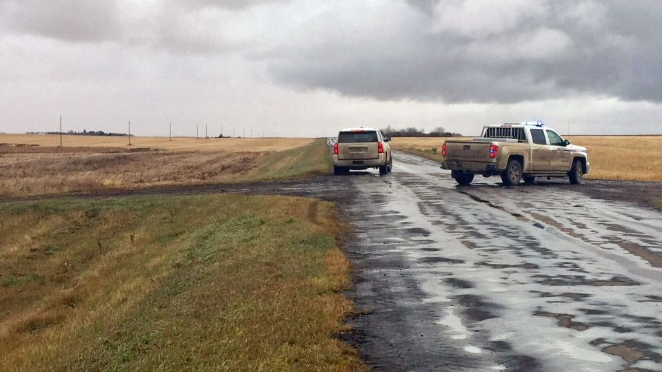 RCMP vehicles block a road in the Maidstone and Paynton area of Saskatchewan after an incident that began in Edmonton prompted a heavy police presence in the west-central Saskatchewan region on Thursday, Oct. 12, 2017. (Laura Woodward/CTV Saskatoon)