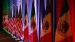 In this Aug. 16, 2017 file photo, the national flags of Canada, from left, the U.S. and Mexico, are lit by stage lights before a news conference, at the start of North American Free Trade Agreement renegotiations in Washington D.C. (AP Photo / Jacquelyn Martin, File)