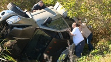 Rescuers trying to free woman after rollover.