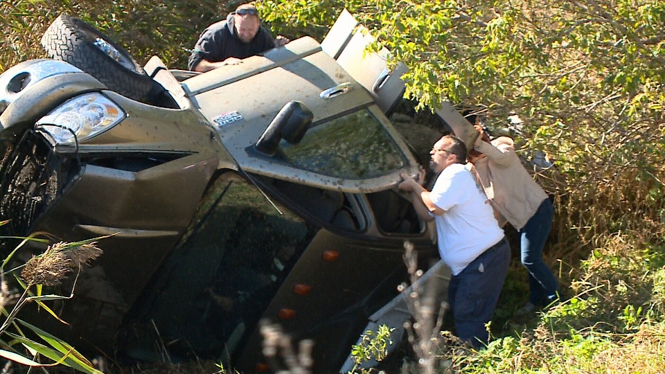 Rescuers trying to free woman after a rollover on highway 17 near Alfred, Ont. around 12:30 p.m. on Thursday, Oct. 12, 2017.