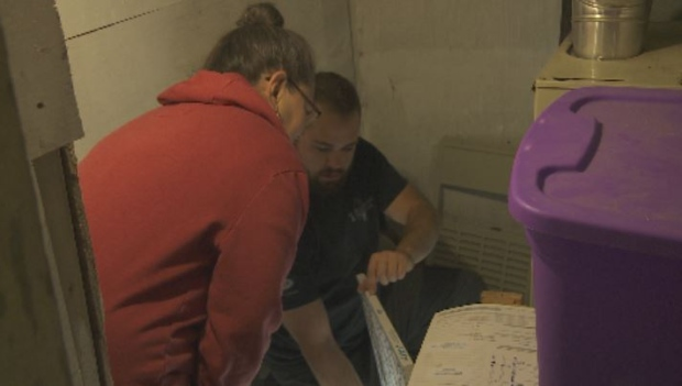 Heating contractor explaining furnace filter care