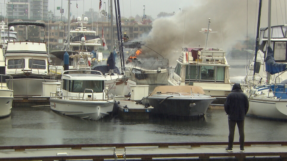 A boat fire is seen in Yaletown on Thursday, Oct. 12, 2017.