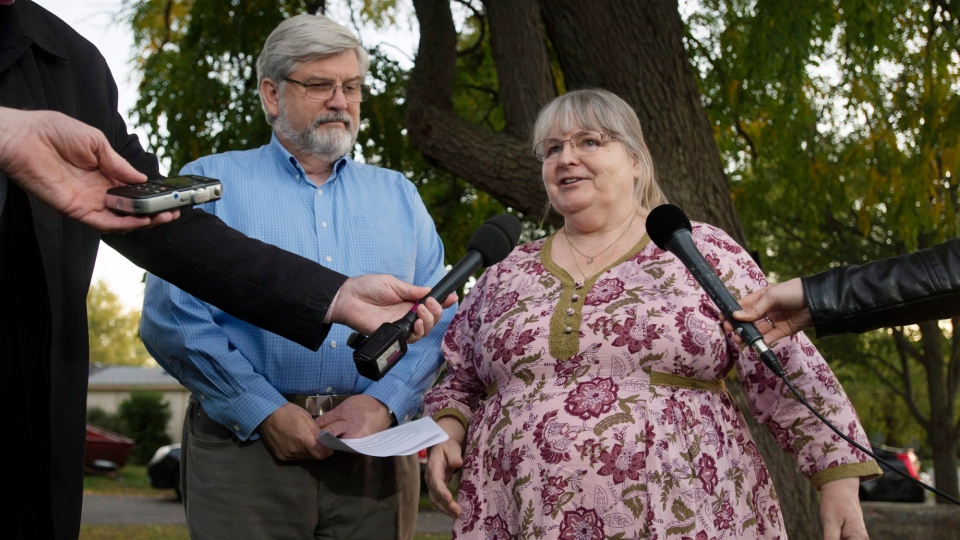 "Linda and Patrick Boyle speak with the media outside their home in Smiths Falls, Ont., on Thursday, October 12, 2017. B""The family has chosen Canada,"" Patrick Boyle said Thursday evening. ""We're hoping to know ourselves when we get to go pick them up."" THE CANADIAN PRESS/Adrian Wyld"