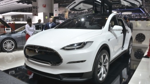 The number of Model X vehicles being recalled was estimated at 11,000, with only a small percentage expected to have the seat cable problem. (© Newspress)
