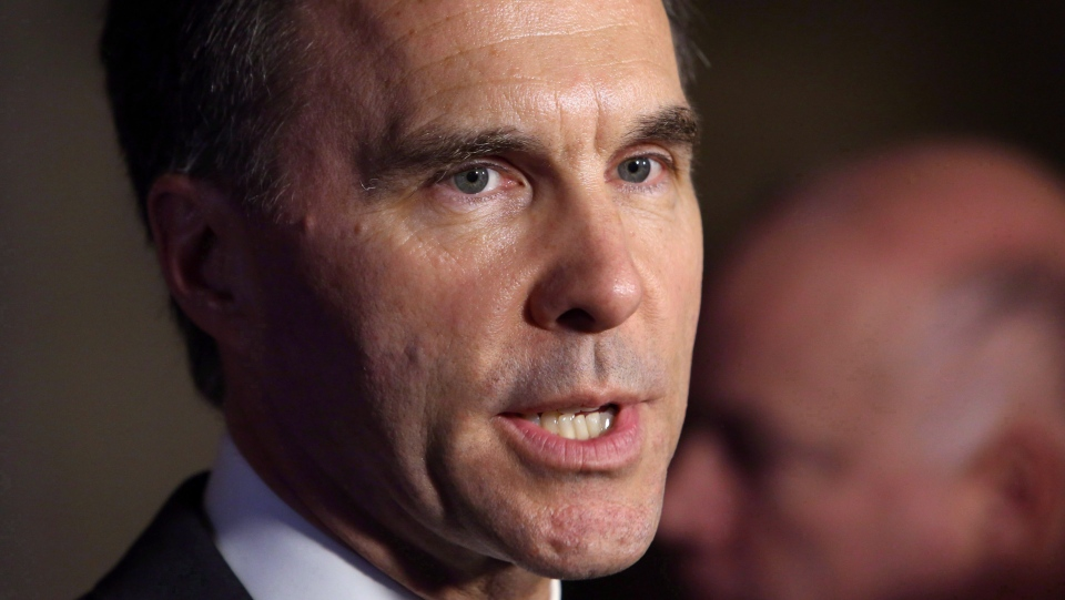 Morneau talks to reporters after Question Period in the House of Commons in Ottawa, Tuesday, October 3, 2017. (Fred Chartrand / THE CANADIAN PRESS)
