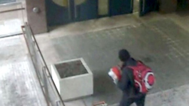 An image taken from surveillance camera footage of a suspect charged with mischief after a package was found outside Toronto Police headquarters on October 12, 2017.