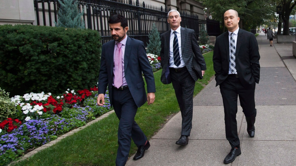 Daniel Westreich, left, Associate Vice-President, Senior Corporate Counsel at Sears Inc., Philip Mohtadi, centre, General Counsel and Corporate Secretary at Sears Inc., and Billy Wong, right, Chief Financial Officer at Sears Inc., arrive at the Ontario Superior Court in Toronto on Friday, October 13, 2017. Sears are seeking approval for a full liquidation of its remaining stores as early as Oct. 19, putting another 12,000 employees out of a job. THE CANADIAN PRESS/Nathan Denette