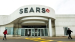 People walk in and out of a Sears store in Mississauga, Ont., on Wednesday, October 11, 2017. Sears Canada Inc. has decided to shut its doors and is seeking approval to liquidate its roughly 130 remaining store, leaving another 12,000 employees across the country without a job. THE CANADIAN PRESS/Nathan Denette