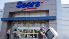 In this July 21, 2017 file photo, customers enter and leave the Sears store in St. Eustache, Quebec. (Ryan Remiorz/The Canadian Press via AP, File)