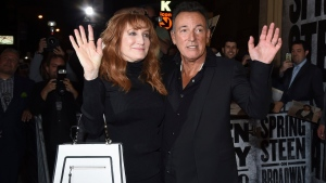 """Musician Bruce Springsteen and his wife Patti Scialfa exit out the stage door after the """"Springsteen On Broadway"""" opening night performance at the Walter Kerr Theatre on Oct. 12, 2017, in New York. (Evan Agostini/Invision/AP)"""
