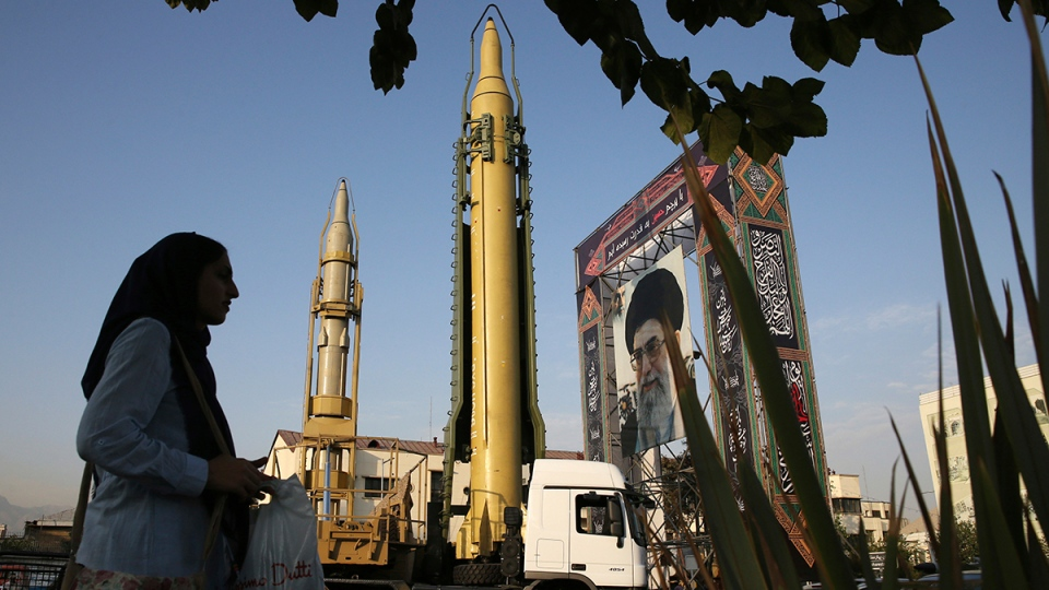 A Ghadr-H missile, centre, a solid-fuel surface-to-surface Sejjil missile and a portrait of the Supreme Leader Ayatollah Ali Khamenei are displayed at Baharestan Square in Tehran, Iran, for the annual Defense Week which marks the 37th anniversary of the 1980s Iran-Iraq war, Sunday, Sept. 24, 2017. (AP / Vahid Salemi)