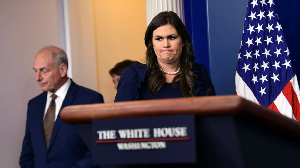 White House Chief of Staff John Kelly, left, arrives with White House press secretary Sarah Huckabee Sanders for the daily press briefing at the White House in Washington, Oct. 12, 2017. (AP / Susan Walsh)