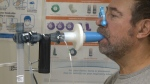 Man using lung function machine