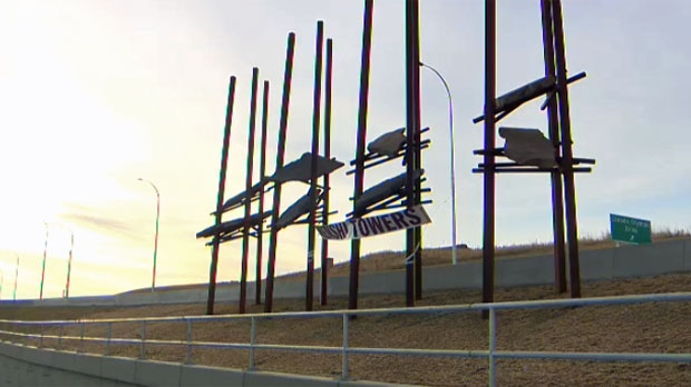 A 'Nenshi Towers' banner was placed on the Bowfort Towers art installation at the Bowfort Road interchange