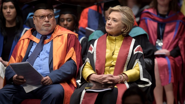 Hillary Rodham Clinton, right, sits in the Great Hall at Swansea University, prior to receiving an Honorary Doctorate, in Swansea, Wales, Saturday, Oct. 14, 2017. (Ben Birchall/PA via AP)