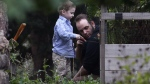 Joshua Boyle and his son Jonah play in the garden at his parents' house in Smiths Falls, Ont., on Saturday, Oct. 14, 2017. (Lars Hagberg/THE CANADIAN PRESS)