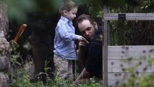 Joshua Boyle and his son Jonah play in the garden