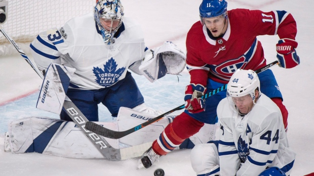 Montreal Canadiens' Brendan Gallagher (11) moves in on Toronto Maple Leafs goalie Frederik Andersen as Leafs' Morgan Rielly (44) defends during third period NHL hockey action in Montreal, Saturday, October 14, 2017. THE CANADIAN PRESS/Graham Hughes