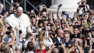 Pope Francis is cheered by faithful as he leaves at the end of a canonization mass in St. Peter's Square at the Vatican, Sunday, Oct.15, 2017. (Giuseppe Lami/ANSA Via AP)