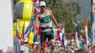 Lionel Sanders, of Canada, crosses the finish line in second place at the Ironman World Championship Triathlon, Saturday, Oct. 14, 2017, in Kailua-Kona, Hawaii. (AP Photo/Marco Garcia)