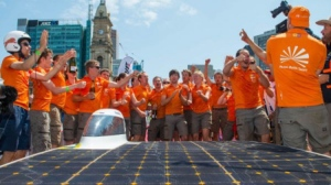 Archive photo of Dutch team and Nuna solar car in 2015. Brenton Edwards / AFP