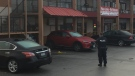 Police are shown investigating at the scene of the city's latest homicide on Sunday morning. (Nick Dixon)