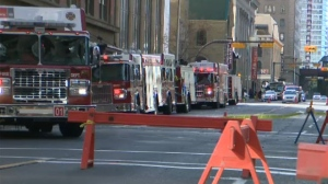 CFD engines parked along 1 St SW after glass fell from the 51st floor of the Brookfield Place building