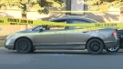 Damaged car being crime scene tape following an October 15 shooting in Falconridge that left two teenagers injured