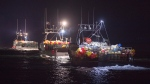 Lobster boats head to drop their traps from Digby, N.S. on Saturday, Oct. 14, 2017. When police confirmed two fishing boats had been torched earlier this week in western Nova Scotia, a simmering dispute over the province's Indigenous lobster fishery suddenly took on a new sense of urgency. (THE CANADIAN PRESS/Andrew Vaughan)