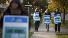 Striking faculty walk the picket line at Humber College Lakeshore campus on Oct. 16, 2017.  (Cole Burston / THE CANADIAN PRESS)