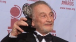 In this file photo dated Sunday, June 4, 2000, Roy Dotrice poses with his Tony award for Best Featured Actor in a Play for his work in 'A Moon For The Misbegotten,' at the 54th annual Tony Awards ceremony in New York. (AP Photo/Richard Drew, FILE)