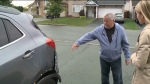 Gordan Scott shows the damage his car sustained after an alleged hit-and-run in Orleans, an Ottawa suburb. (CTV Ottawa)