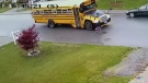 This still image from a neighbour's security video shows a seven-year-old boy about to be struck by a school bus, mere seconds after he disembarked in Abbotsford, B.C., on Oct. 6, 2017.