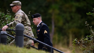 Sgt. Bowe Bergdahl, right, arrives for a motions hearing on Monday, Oct.16, 2017, on Fort Bragg. Bergdahl, who walked off his base in Afghanistan in 2009 and was held by the Taliban for five years, is charged with desertion and misbehavior before the enemy. (AP Photo/The Fayetteville Observer, Andrew Craft)