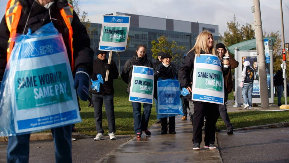 Striking faculty stand on the picket line outside of Humber College, in Toronto on Monday, October 16, 2017. Faculty at 24 Ontario colleges went on strike late Sunday, affecting more than 500,000 students. The Ontario Public Services Employees Union says the two sides couldn't resolve their differences by a strike deadline of 12:01 a.m. Monday. THE CANADIAN PRESS/Cole Burston