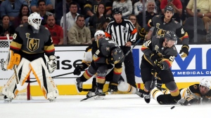 Vegas Golden Knights center Cody Eakin (21) clears the puck asxBoston Bruins left wing Brad Marchand (63) dives late during the second period of an NHL hockey game at T-Mobile Arena, Sunday, Oct. 15, 2017, in Las Vegas. (AP / L.E. Baskow)