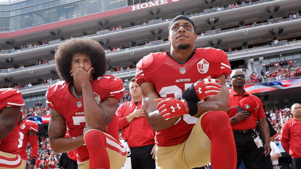 In this Oct. 2, 2016 file photo, San Francisco quarterback Colin Kaepernick, left, and safety Eric Reid kneel during the national anthem before an NFL football game against the Dallas Cowboys in Santa Clara, Calif. (AP Photo/Marcio Jose Sanchez)